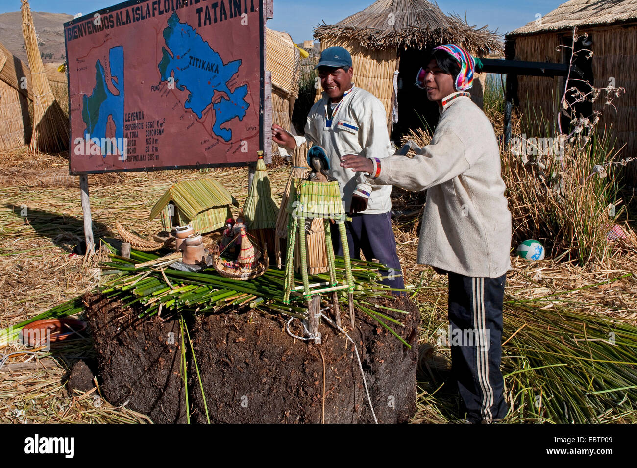 Quechua or Uros Indians on one of 42 floating islands on Lake Titicaca called 'Uros Islands', self-built of totora Stock Photo