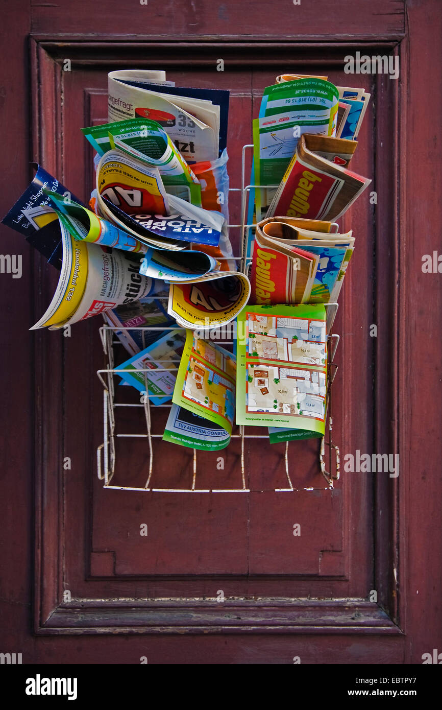 magazines and brochures at a door - Stock Image