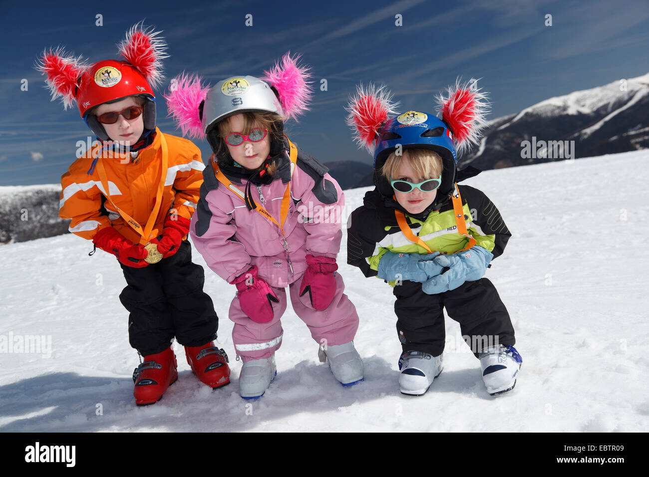 three children with medals of ski race, Austria, Kaernten - Stock Image