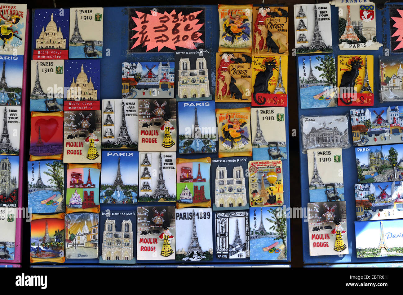 collection of nostalgic postcards at a souvenir booth, France, Paris - Stock Image