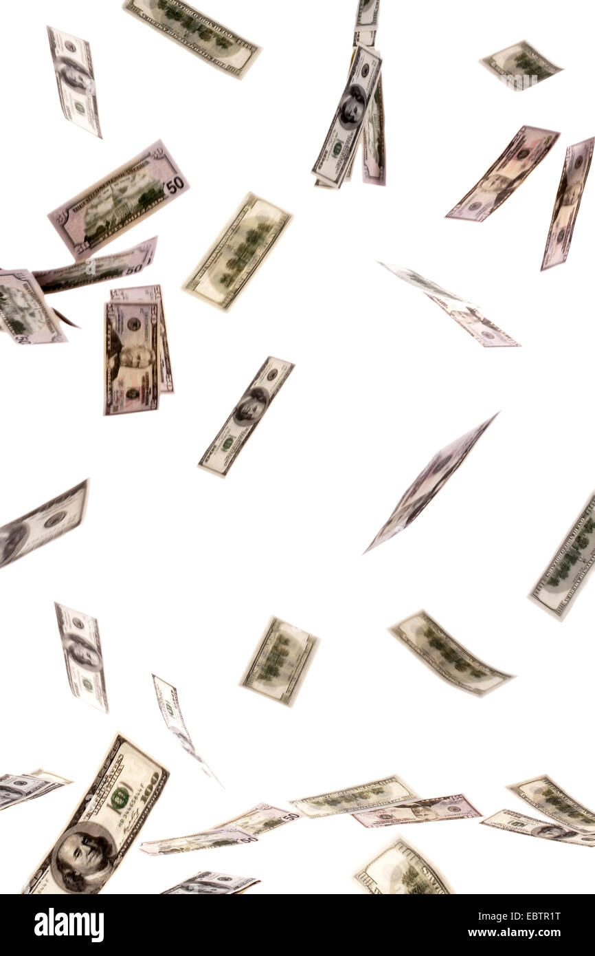 many Dollar bills flying through the air - Stock Image