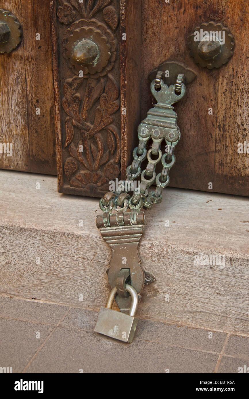 old door closer at a histroical door, Tanzania, Sansibar, Stone Town - Stock Image