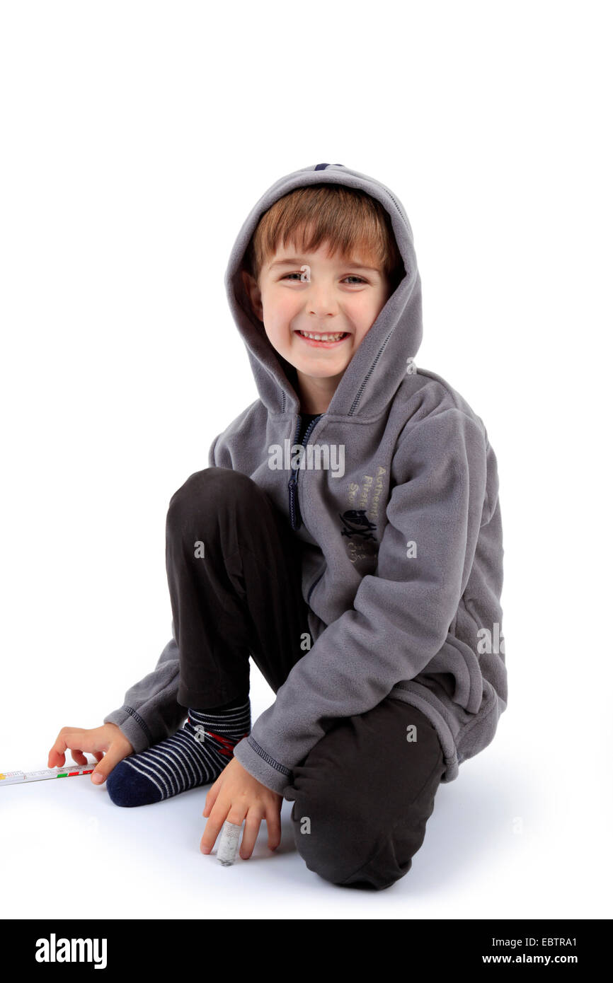 little boy playing with a folding rule - Stock Image