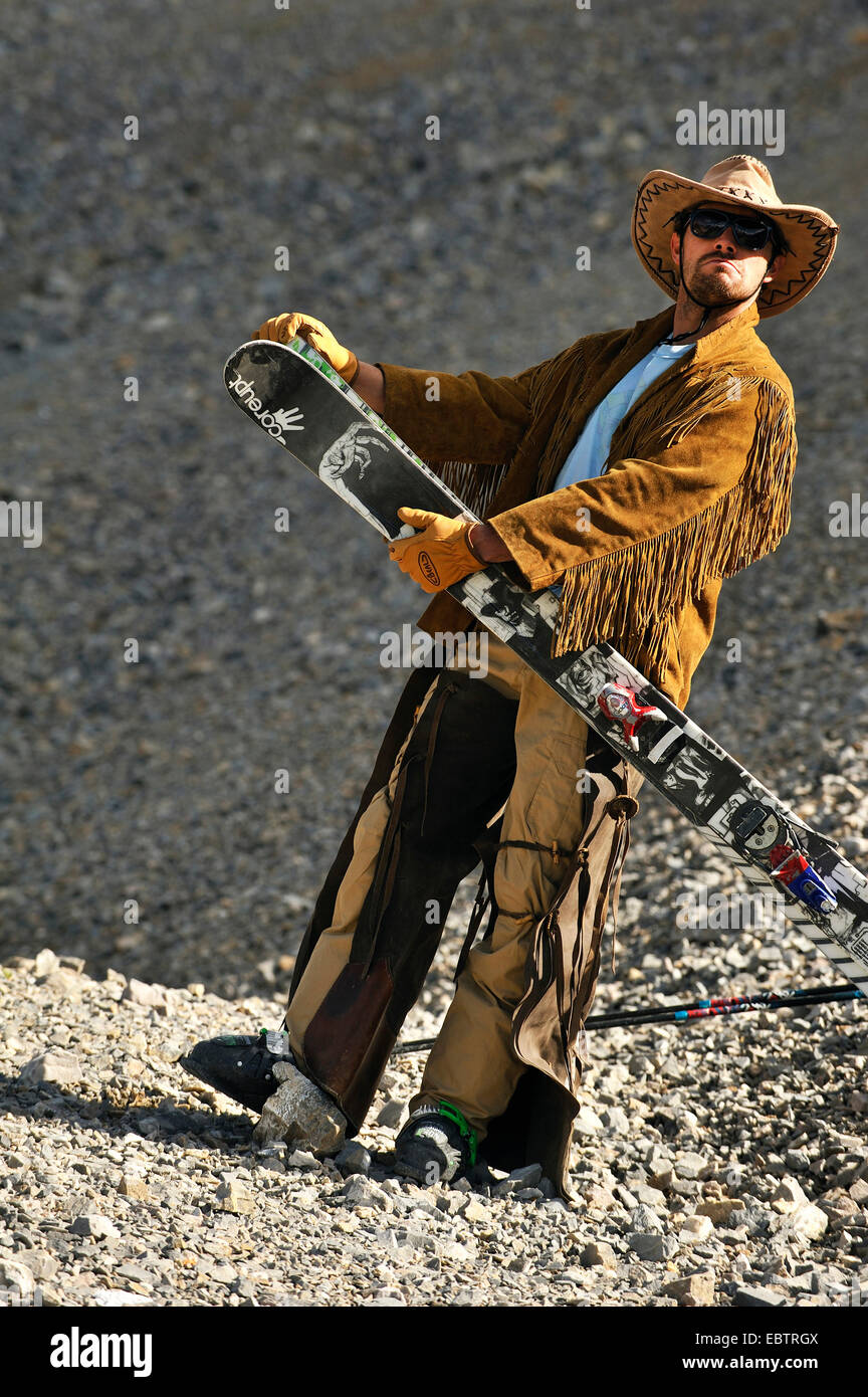freeride skier disguised as cowboy - Stock Image