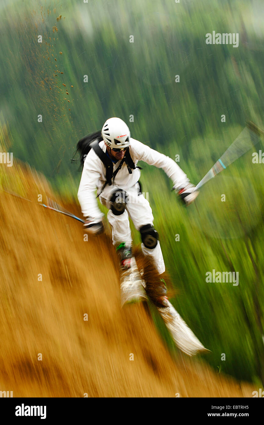 freeride skier going downhill on sandy slope - Stock Image