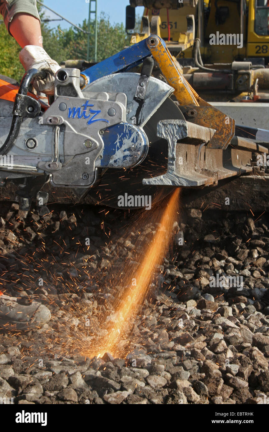 angle grinder cutting a railroad track, Germany, North Rhine-Westphalia - Stock Image