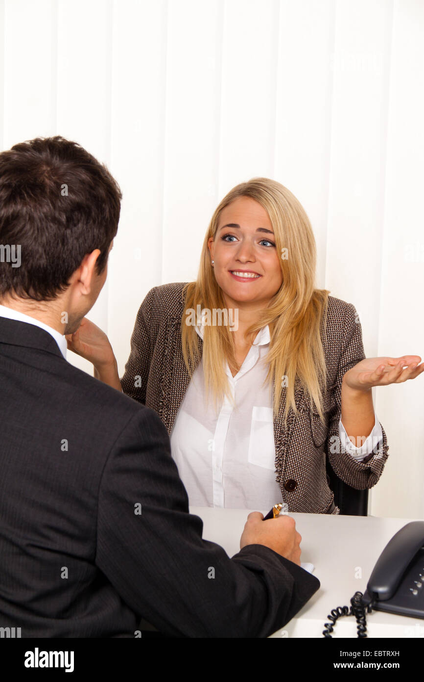 businessman giving an advice to unconfident woman Stock Photo