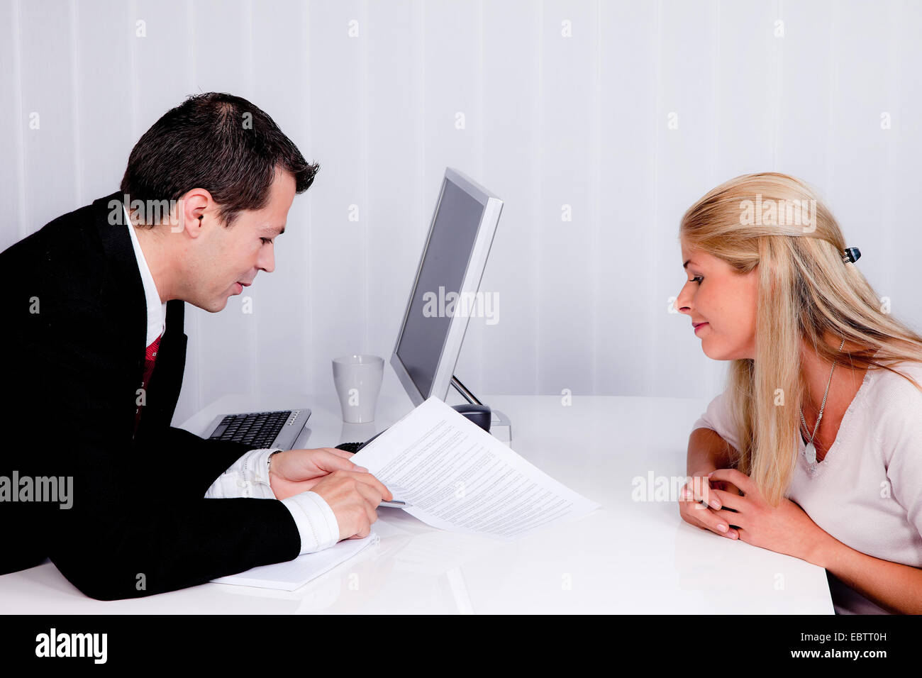 man an woman talking in an office Stock Photo