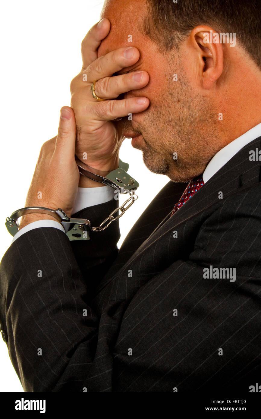 Manager arrested for economic crimes - Stock Image