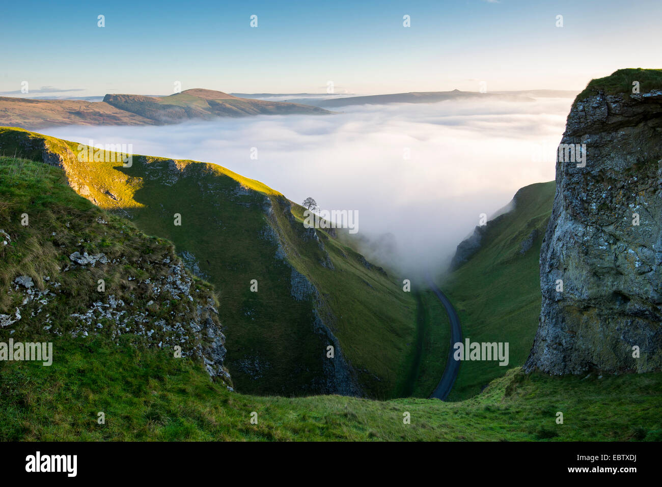 Magical morning of mist and low cloud in the Hope valley. Mist drifting around Winnats Pass creating atmospheric - Stock Image