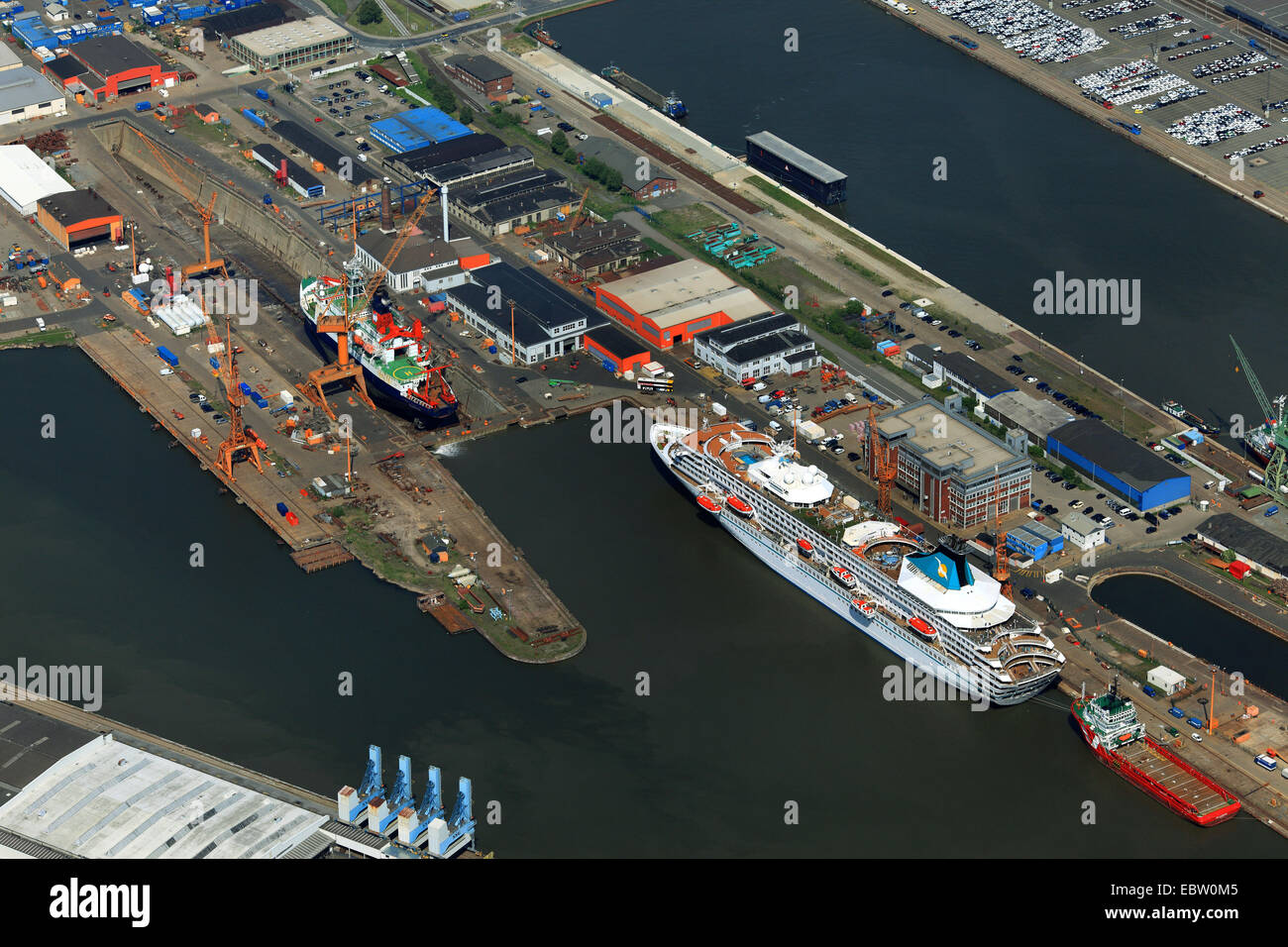 port basins with passenger ship Ariana and research ship Polarstern at dry-dock, Germany, Bremerhaven - Stock Image