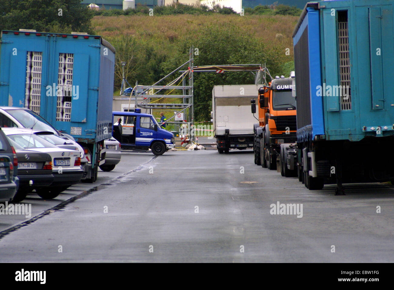 , vehicles of a mobile task force of epidemiologists at a poultry farm hit affected by the bird flu, Germany, - Stock Image