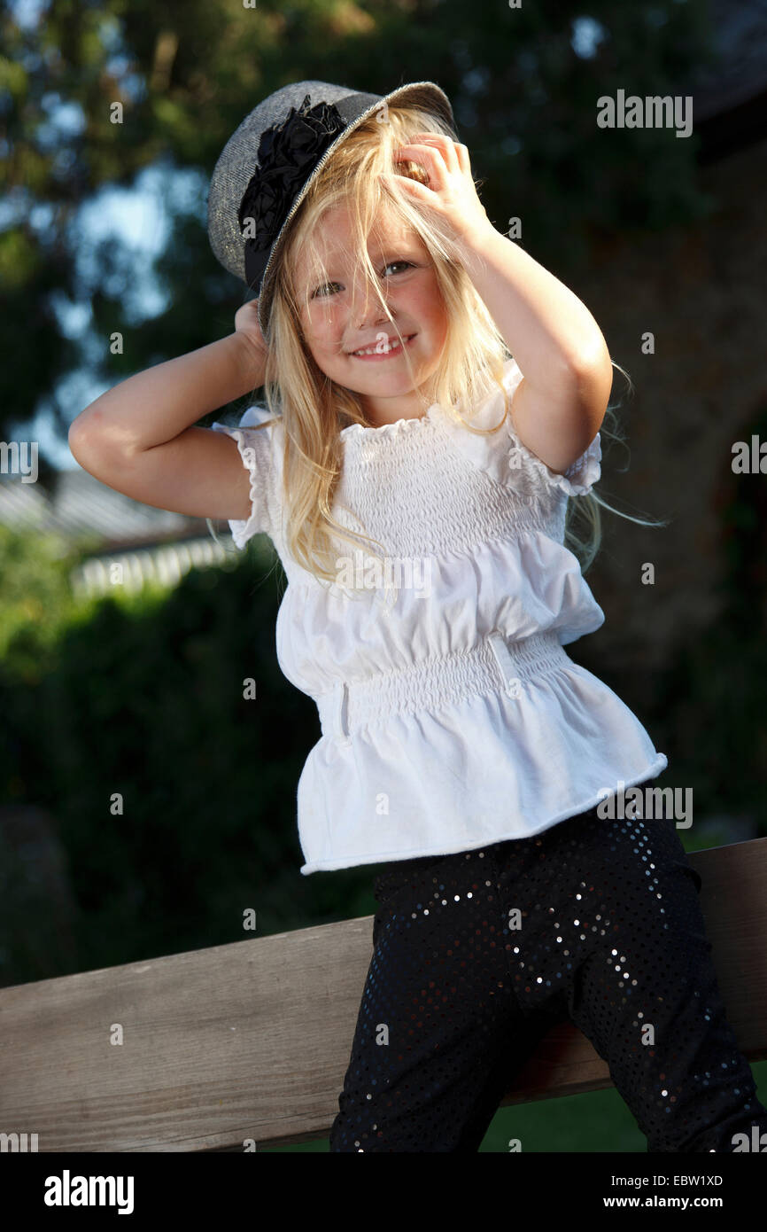 little blond-haired girl with hat - Stock Image