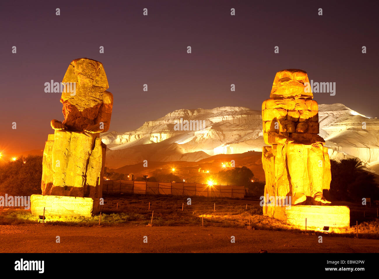 illuminated Colossi of Memnon at night,  two massive stone statues of Pharaoh Amenhotep III, Egypt, Theben-West, Stock Photo