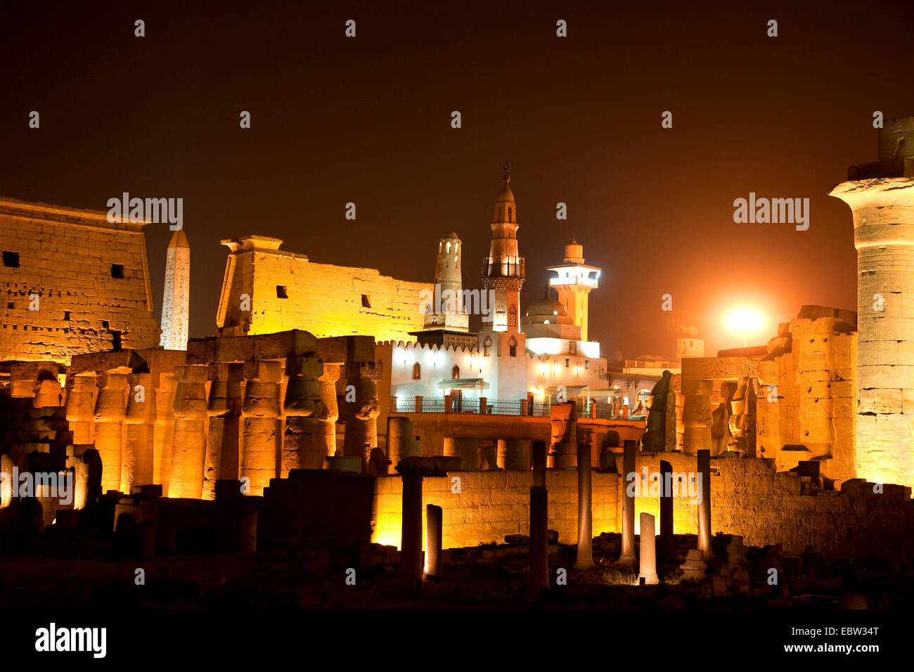 the Luxor Temple with the mosque of the city saint AbuÆl-Haggag in the first inner yard in nightly illumination, Stock Photo