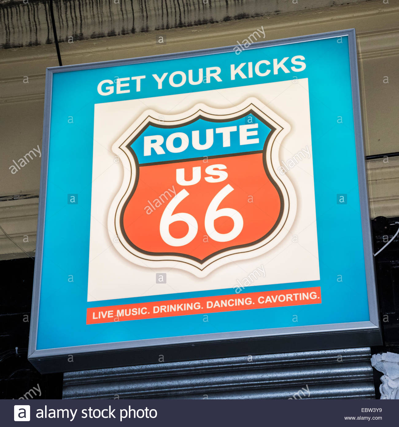 Sign for the Route 66 Club in the Cavern Quarter of Liverpool, offering live music, drinking, dancing and cavorting - Stock Image