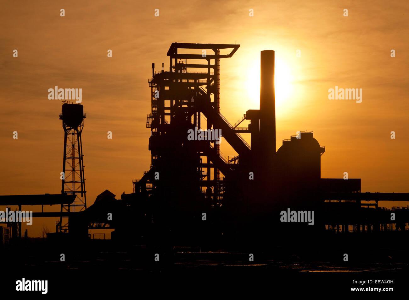silhouette of closed blast furnace Phoenix-West at sunset, Germany, North Rhine-Westphalia, Ruhr Area, Dortmund - Stock Image