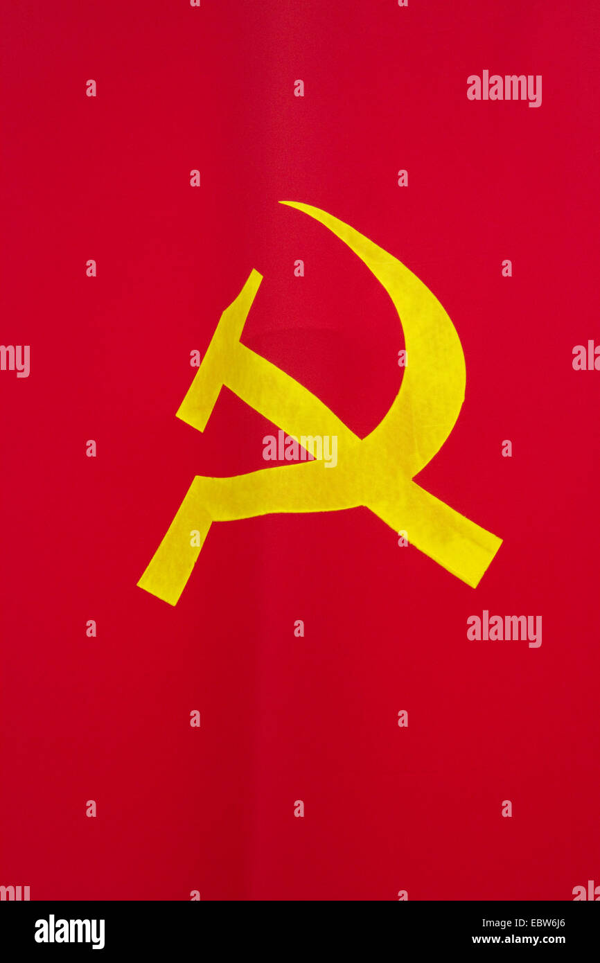 Hammer and sickle design on a communist flag in Ho Chi Minh City, Vietnam. - Stock Image
