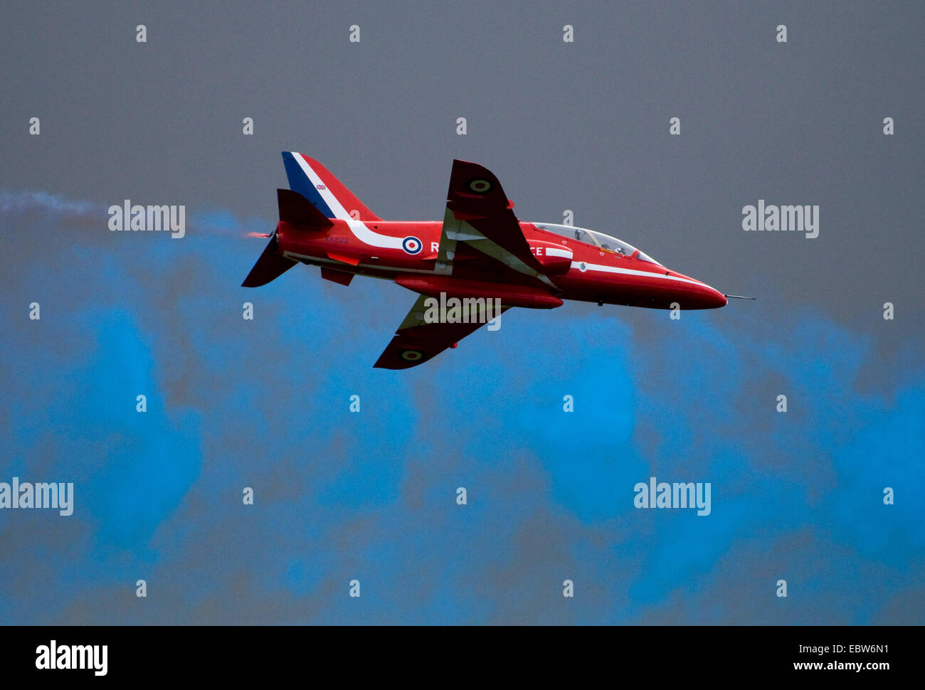 plane from an aerobatic squadron in front of smoke coloured blue, United Kingdom, Scotland - Stock Image