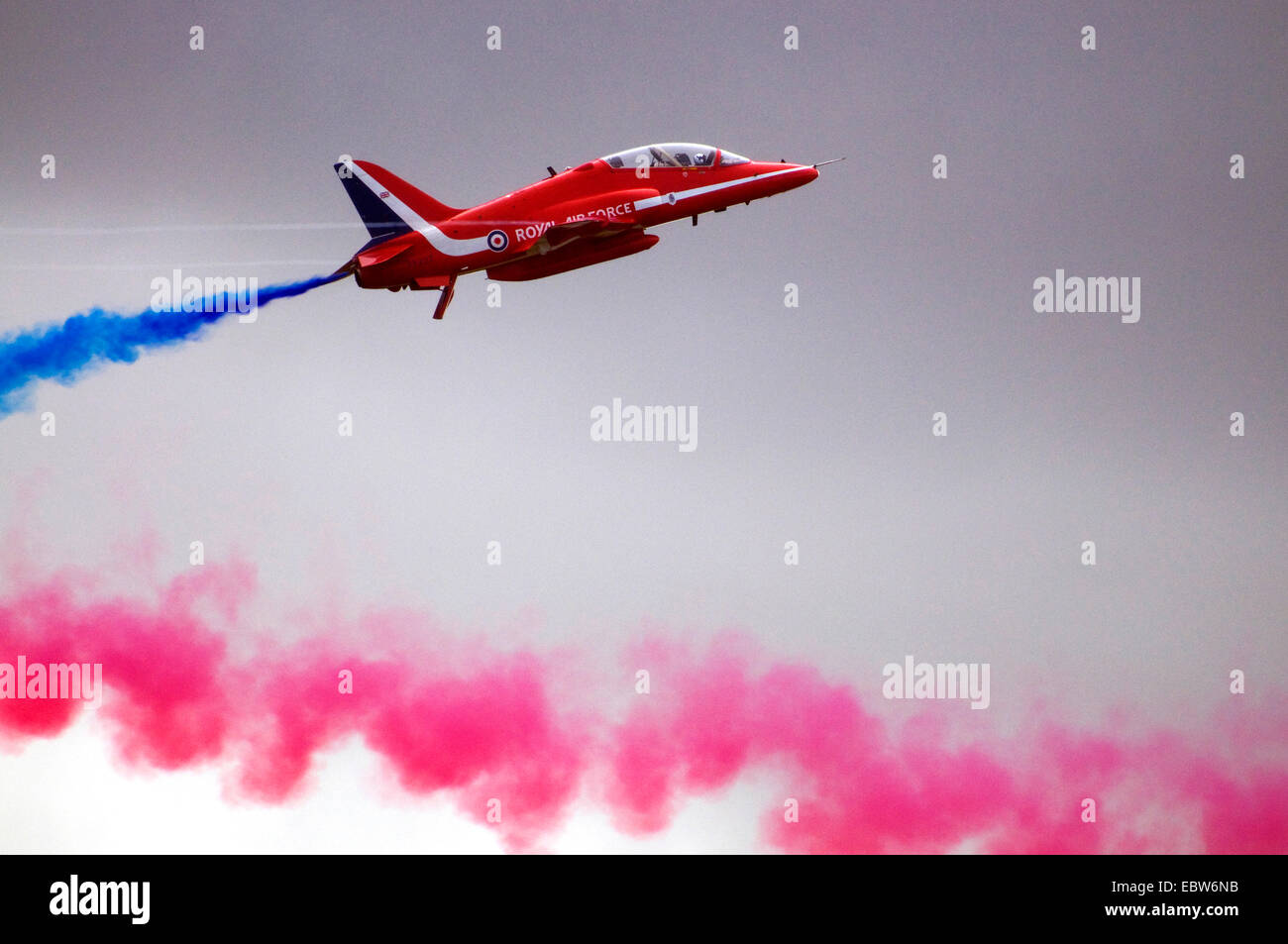 plane from an aerobatic squadron in the sky jetting smoke in the colours of the Union Jack, United Kingdom, Scotland - Stock Image