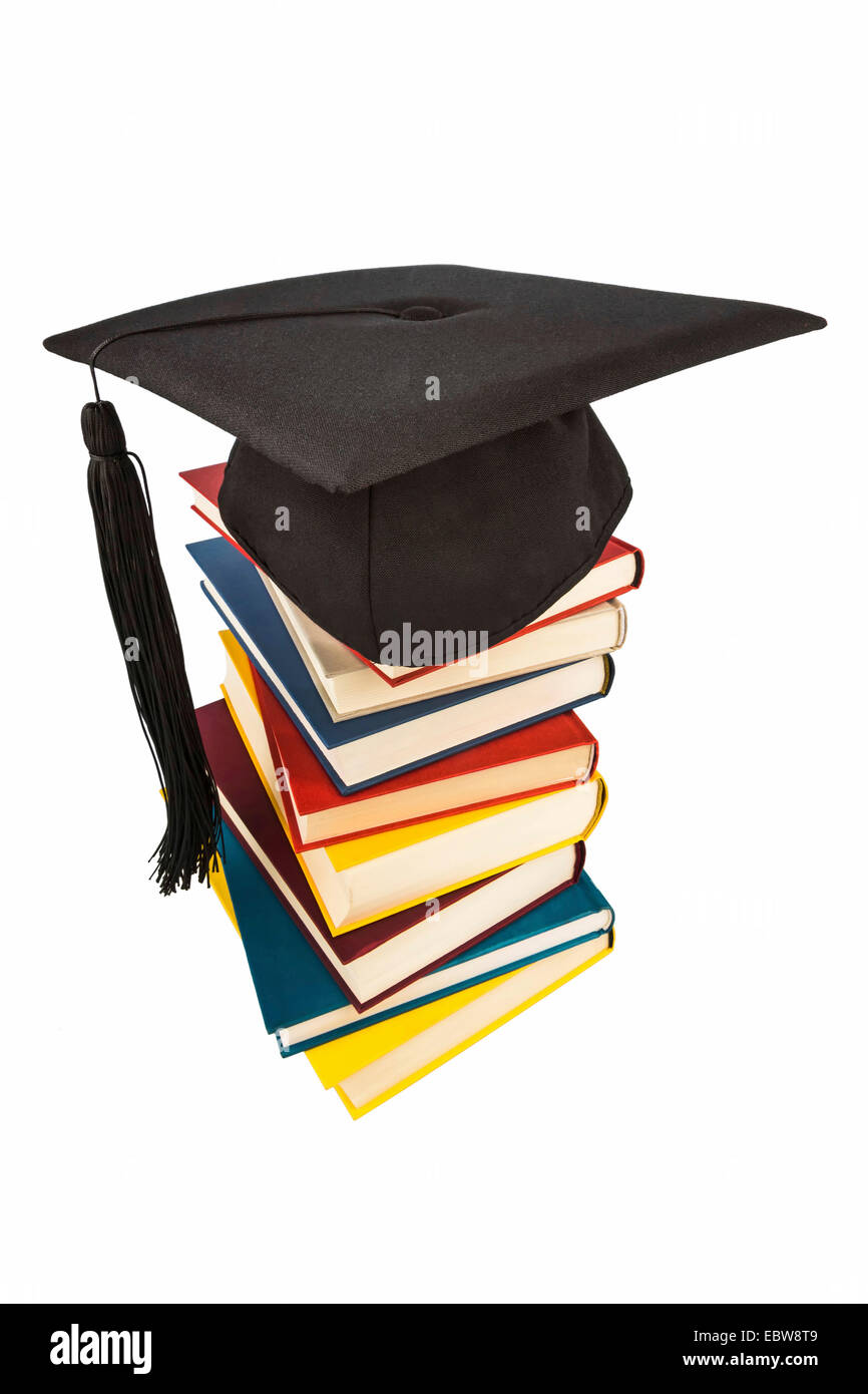 graduation cap on a stack of books, symbol picture for education and competence - Stock Image