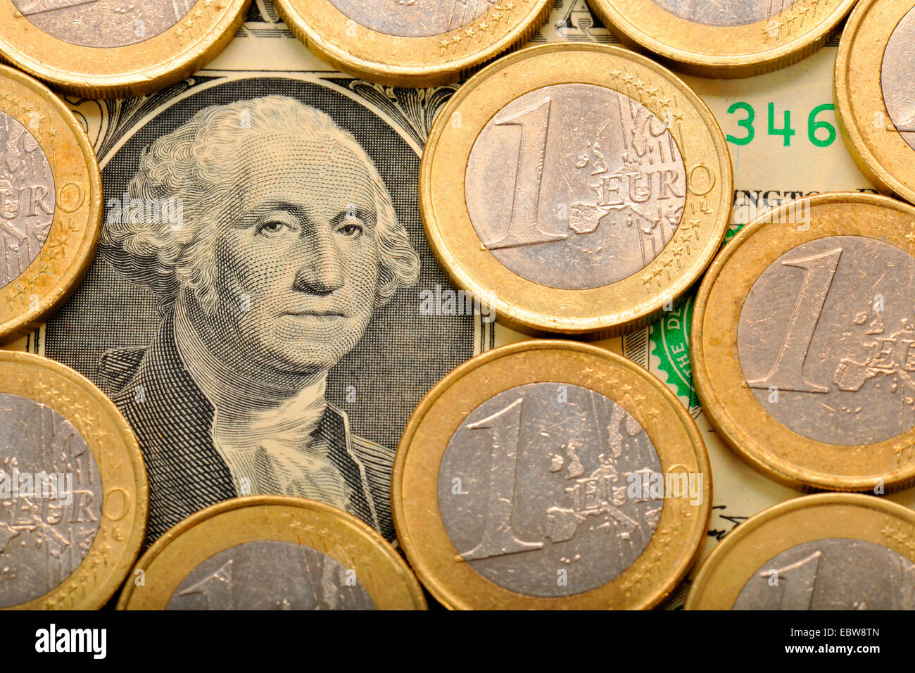 1 dollar bill with 1 euro coins, rate of exchange - Stock Image