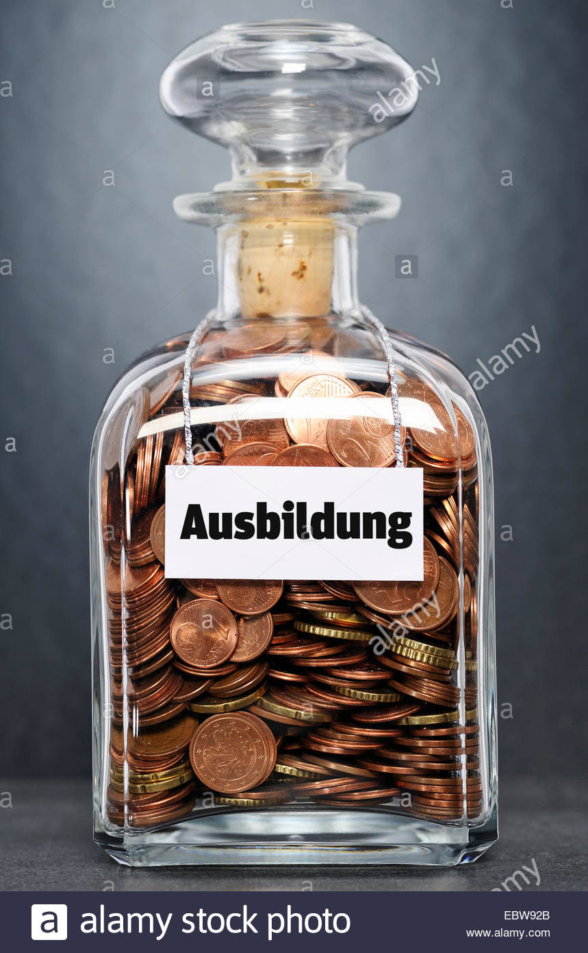 glass bottle with Euro-coins labelled 'education' - 'Ausbildung' - Stock Image