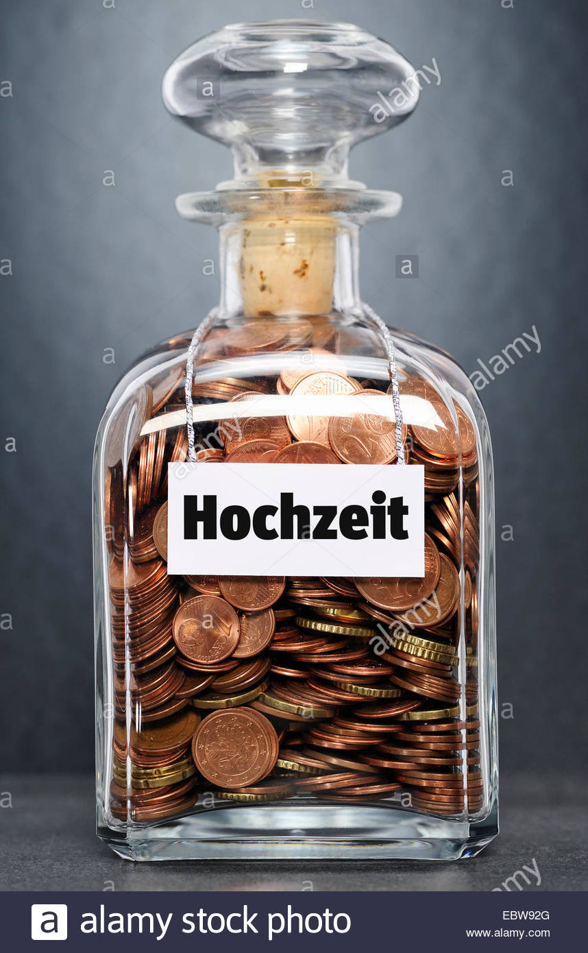 glass bottle with Euro-coins labelled 'wedding' - 'Hochzeit' - Stock Image