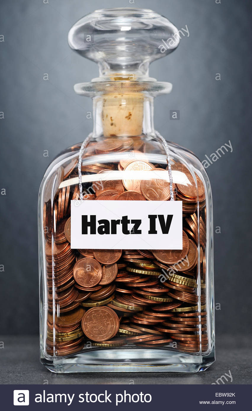glass bottle with Euro-coins labelled 'unemployment benefit' - 'Hartz IV' - Stock Image