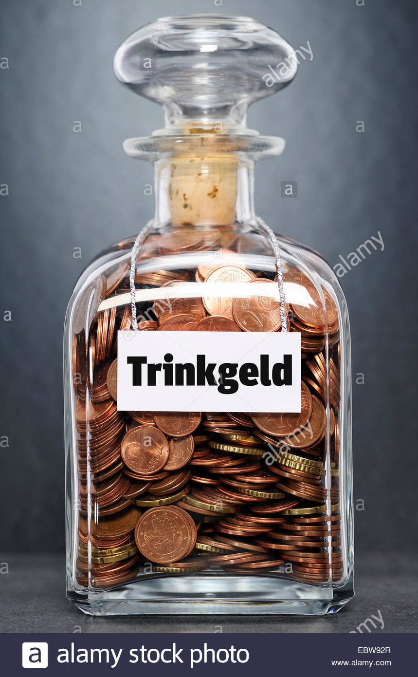 glass bottle with Euro-coins labelled 'donation' - 'Trinkgeld' - Stock Image