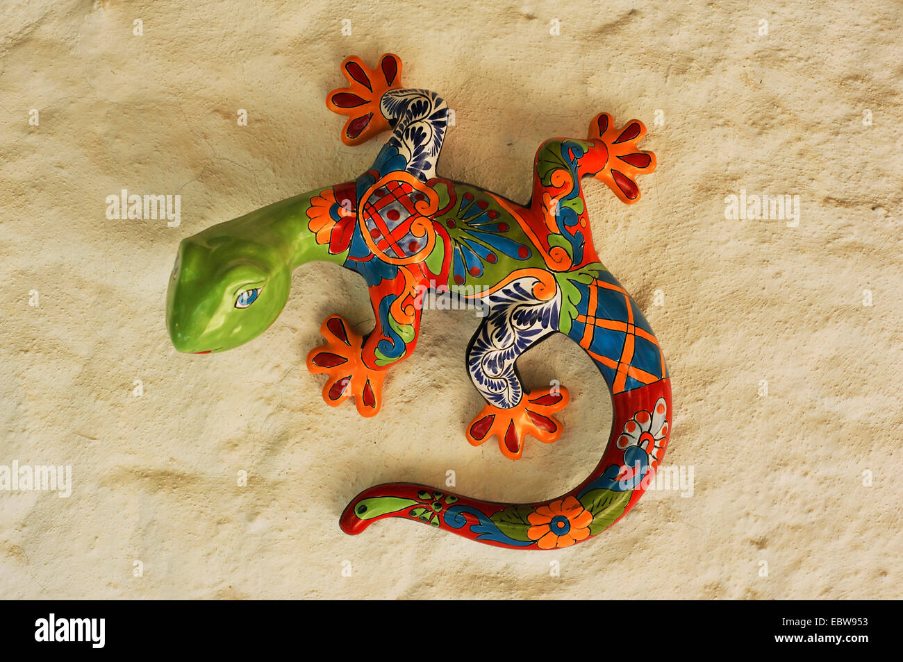 decorative colourful porcelain gecko at a wall of a motel, Mexico ...