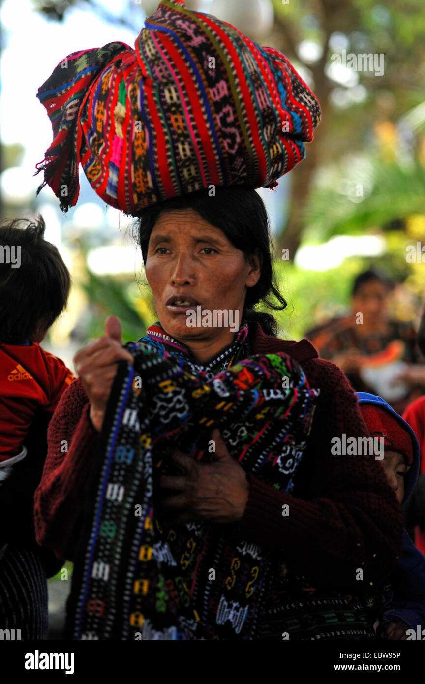 older Maya woman with a bundle on the head on the market, Guatemala, Lake of Atitlan, Solola - Stock Image