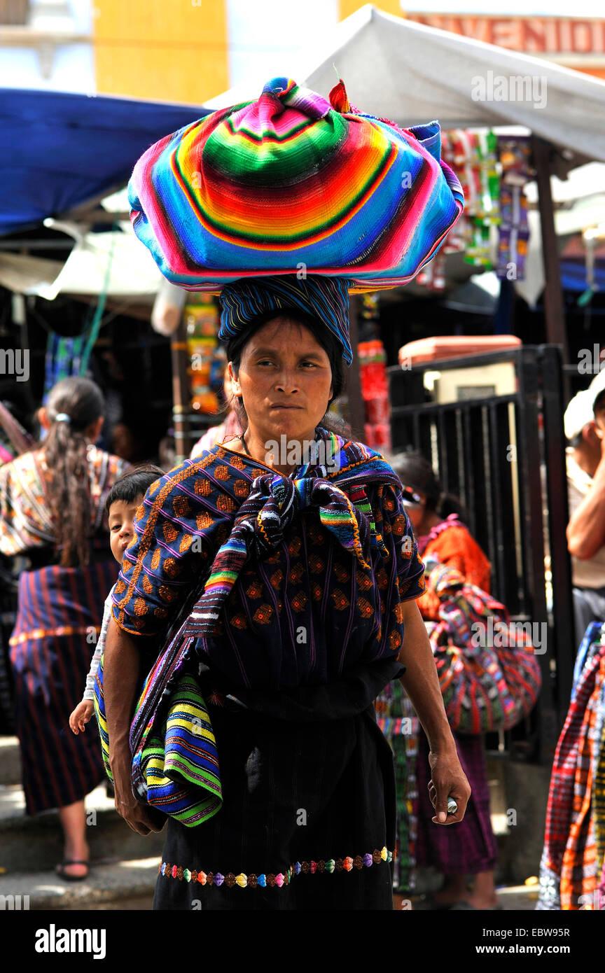 Maya woman with a bundle on the head on the market, Guatemala, Lake of Atitlan, Solola - Stock Image