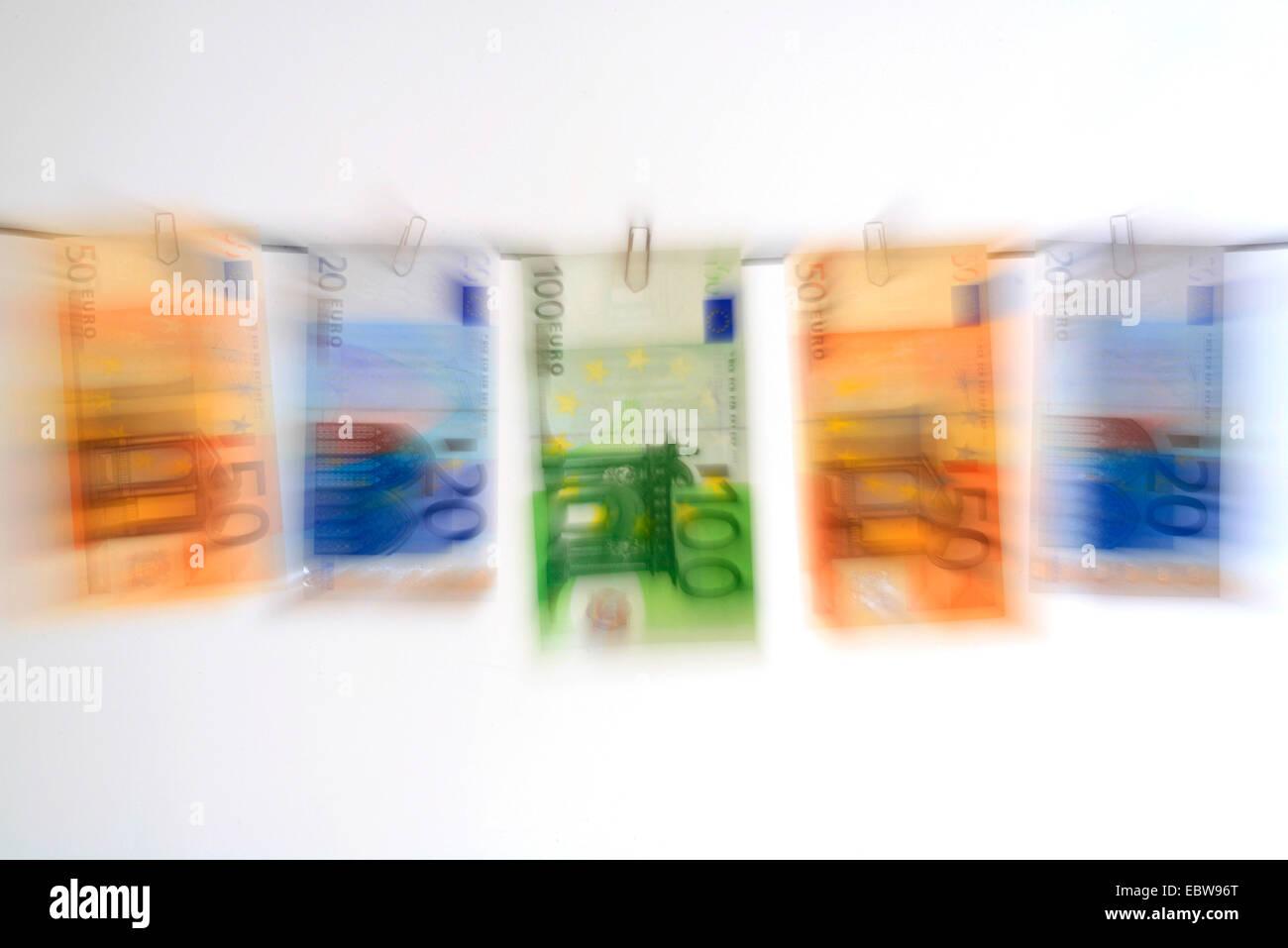 euro bills hanging at a wahing line - Stock Image