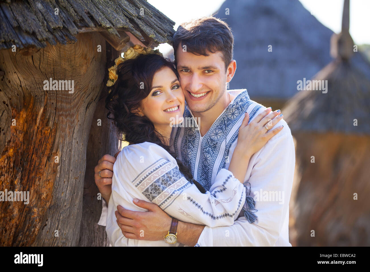 Romantic young couple in ukrainian style clothes outdoors