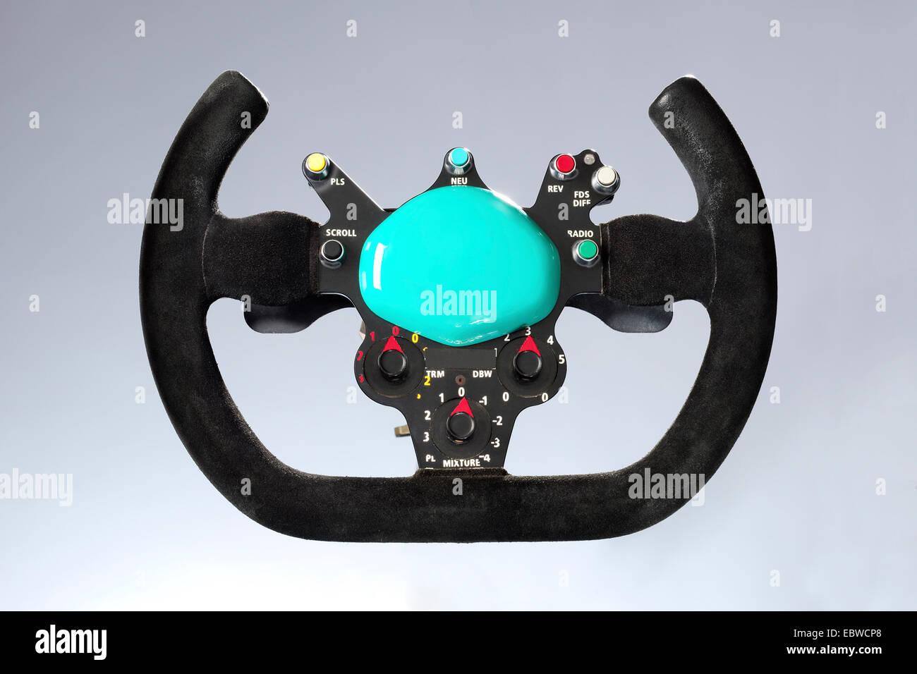 A Racing car steering wheel - Stock Image