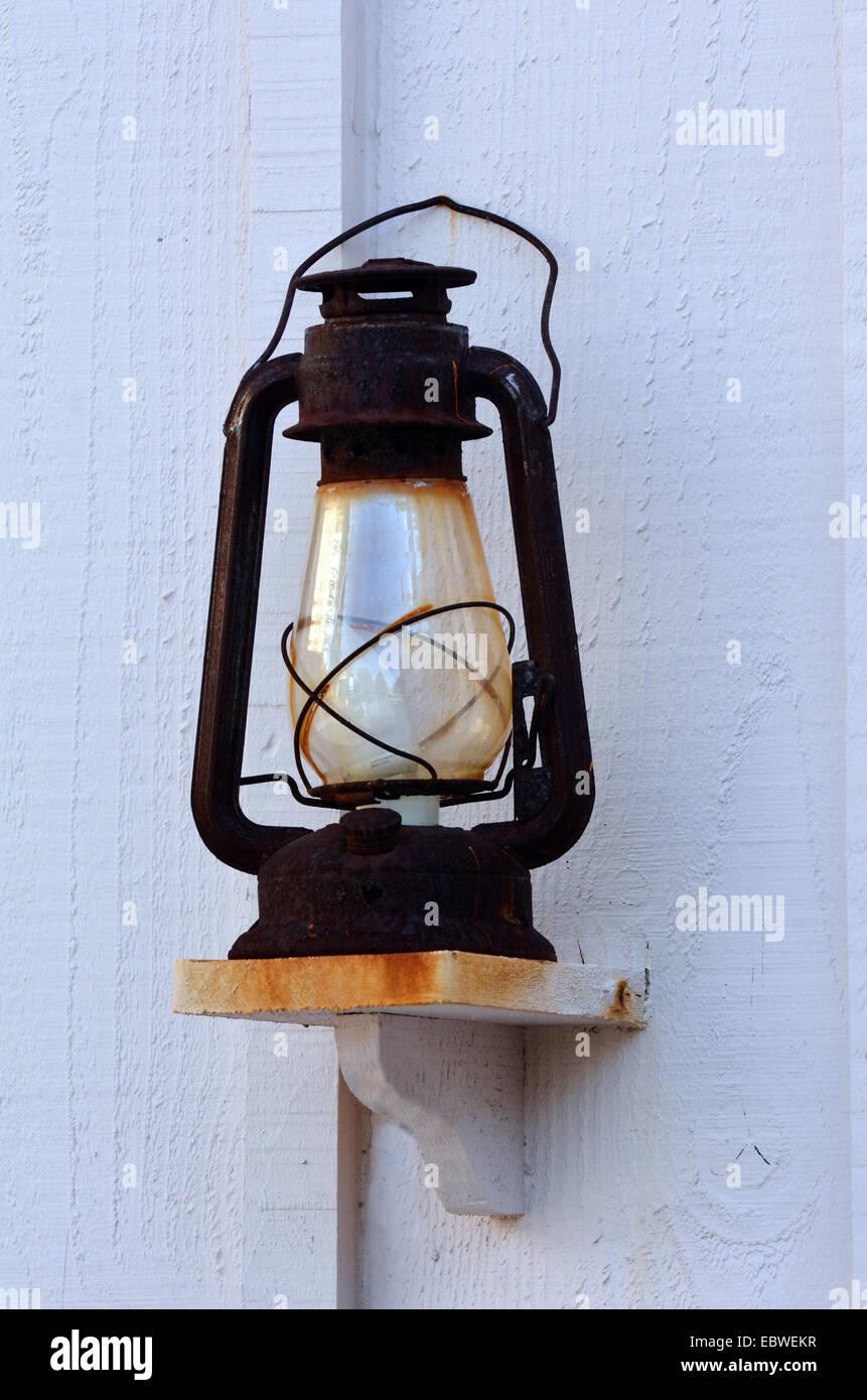 Antique Kerosene Lamp on a wall. - Stock Image