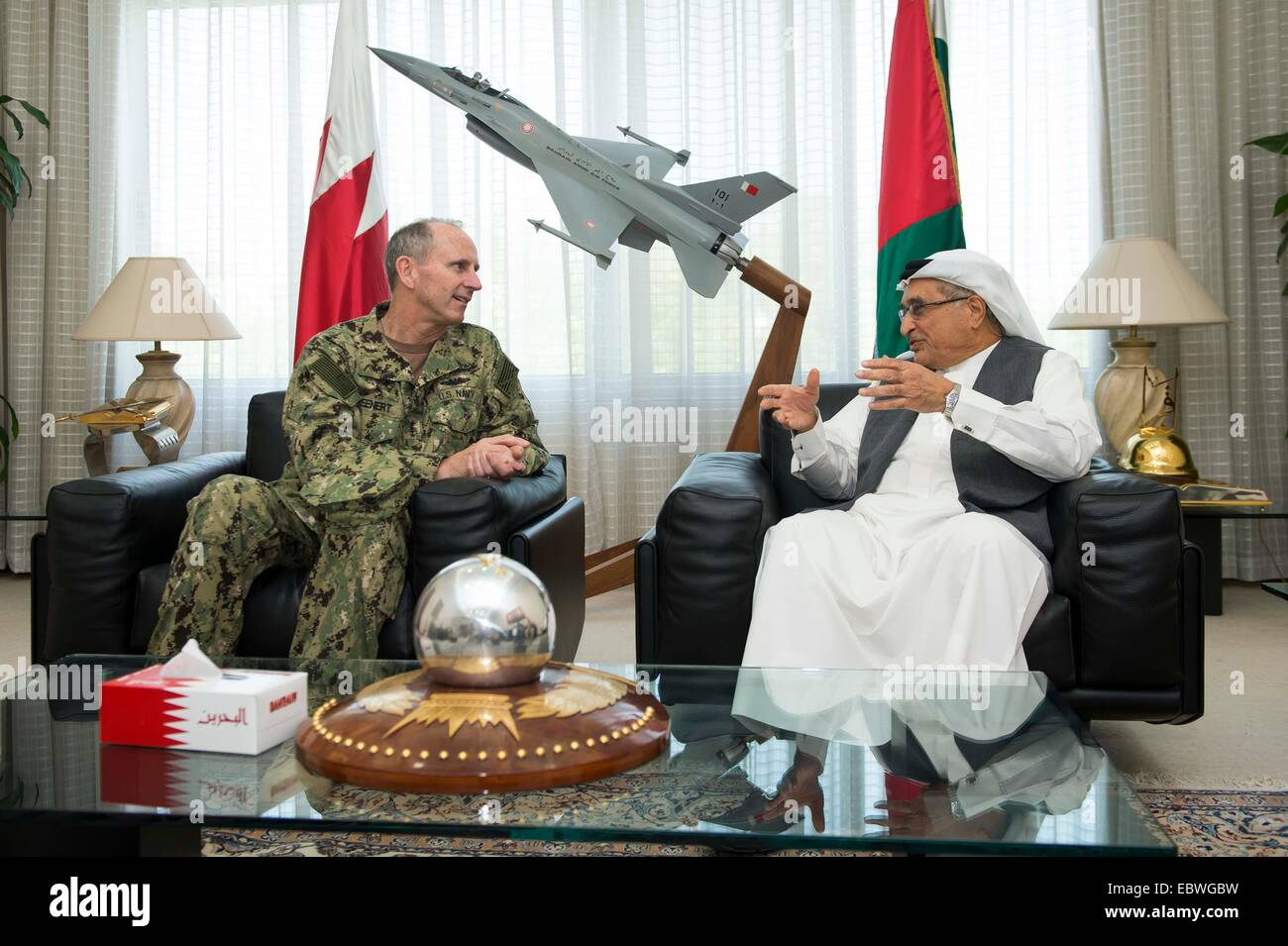 US Chief of Naval Operations Adm. Jonathan Greenert chats with Bahrain Minister of State for Defense Affairs Lt. - Stock Image