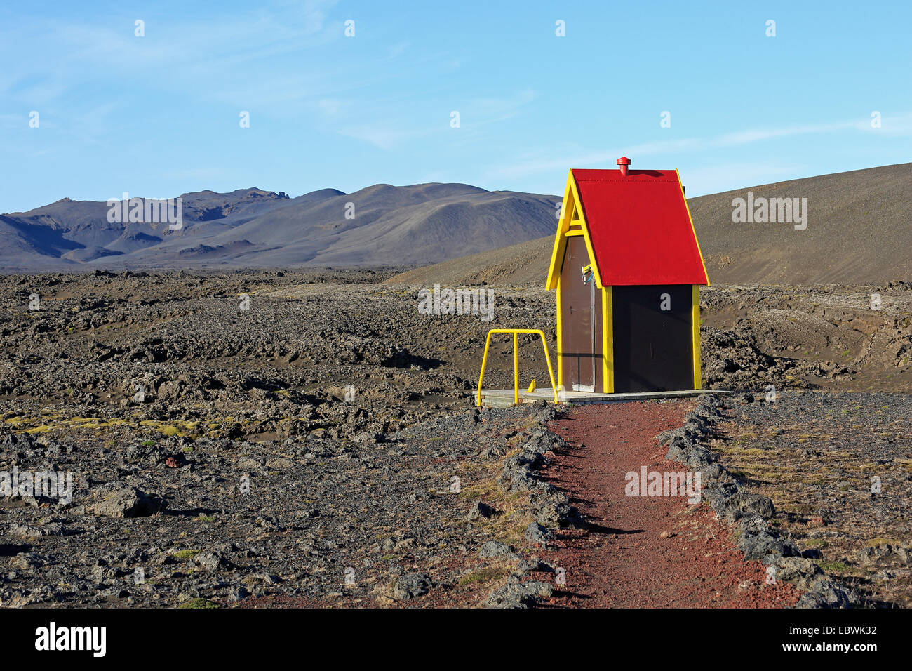 Colourful toilet on a lava field outside of a mountain hut in the highlands in iceland - Stock Image