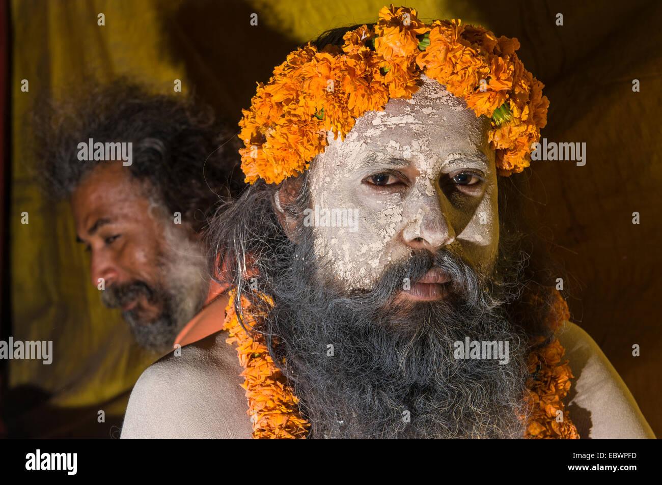 Portrait of a Shiva sadhu, holy man, at the Sangam, the confluence of the rivers Ganges, Yamuna and Saraswati - Stock Image
