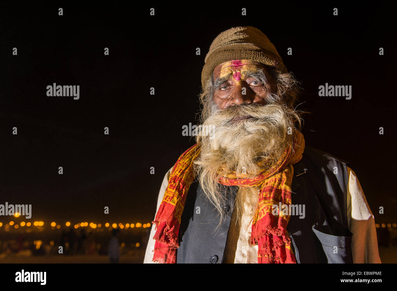 Rama sadhu, holy man, at night at the Sangam, the confluence of the rivers Ganges, Yamuna and Saraswati - Stock Image