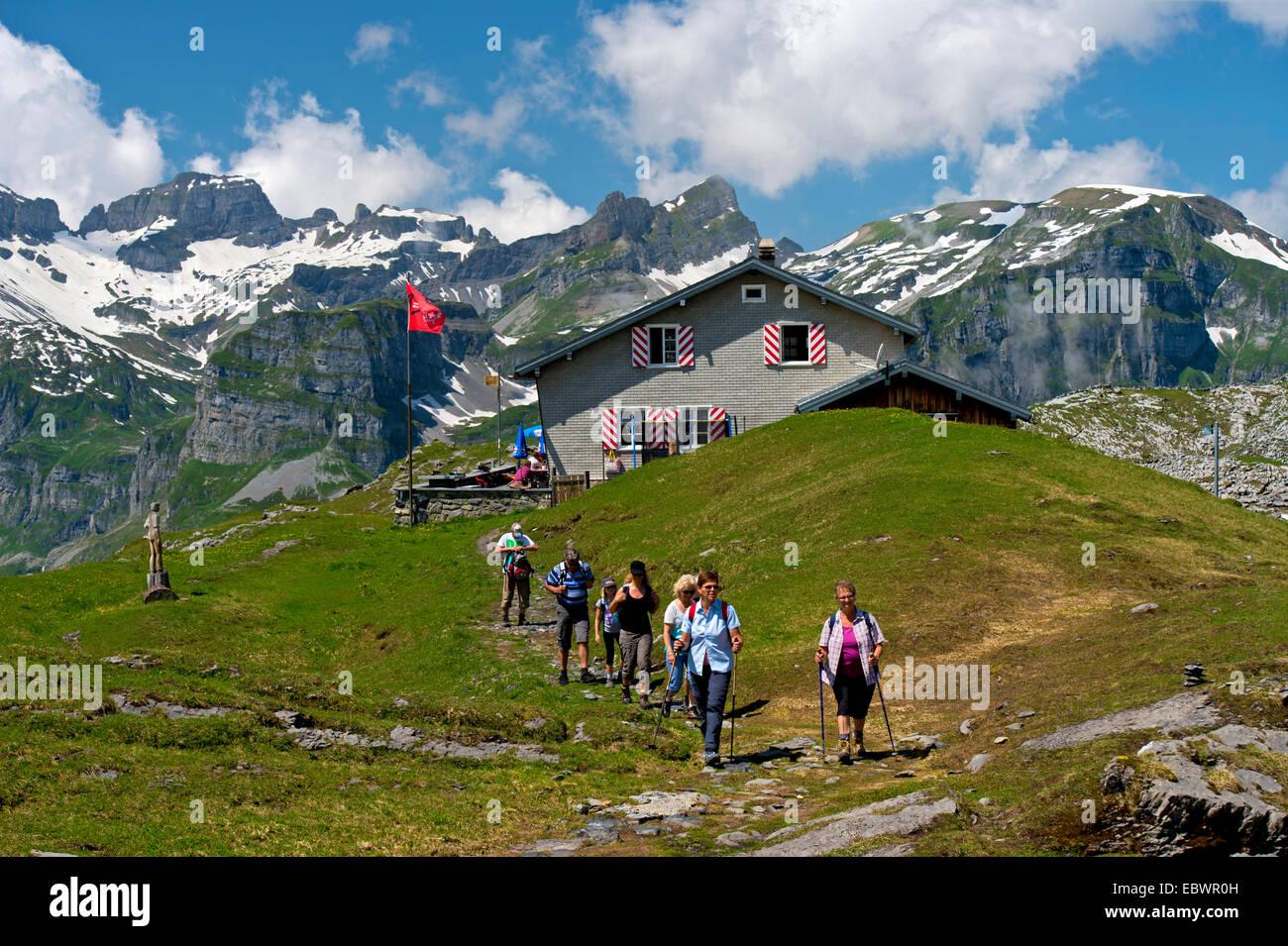 Hikers at the Glattalp Hut, Glarus Alps, Western Alps, Canton of Schwyz, Switzerland - Stock Image