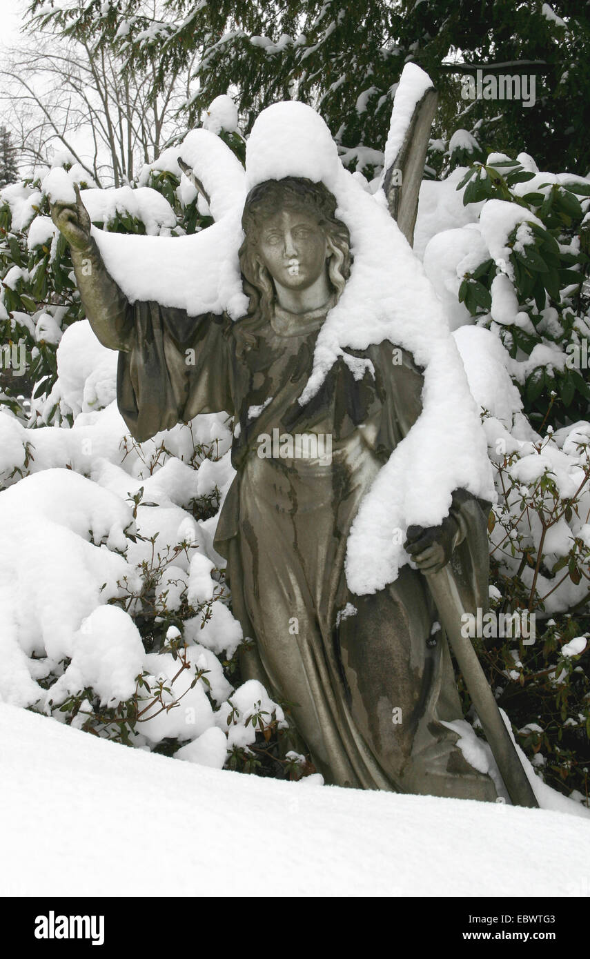 snow-covered statue on a cemetery, Germany, Baden-Wuerttemberg, Baden-Baden - Stock Image