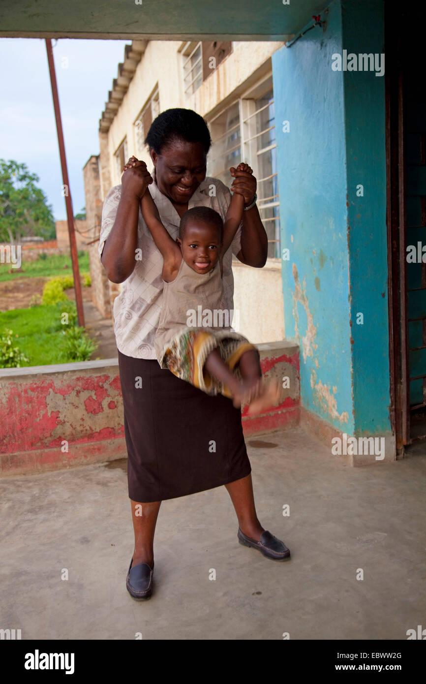 woman playing with her child, Burundi, Bujumbura - Stock Image