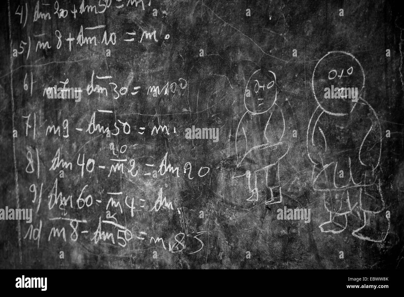 blackboard with calculations and stick-figures in the classroom of an aid organization teaching former street urchins Stock Photo