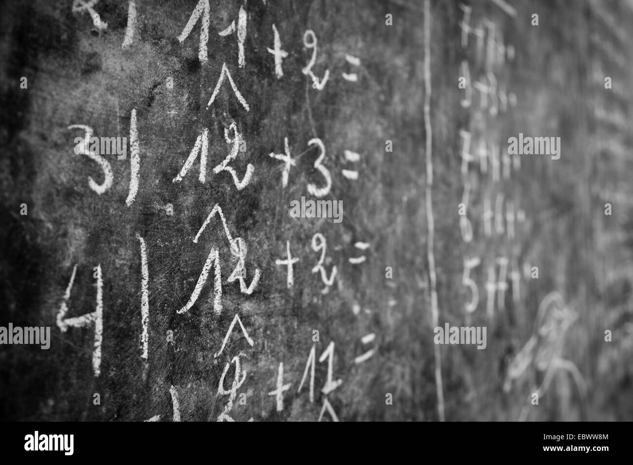 blackboard with calculations in the classroom of an aid organization teaching former street urchins handcrafts and - Stock Image