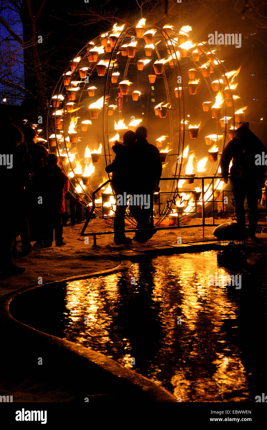 people watching burning globe at a winter event, Canada, Ontario, Toronto - Stock Image