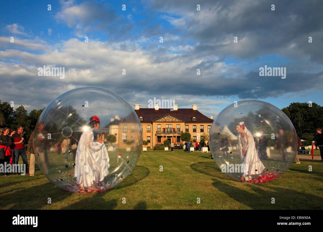 female dancer in lucent balls at festival, Oranienbaum Palace, Germany, Saxony-Anhalt, Oranienbaum - Stock Image