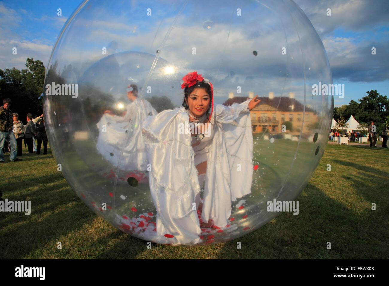 female dancer in a lucent ball at festival, Oranienbaum Palace, Germany, Saxony-Anhalt, Oranienbaum - Stock Image