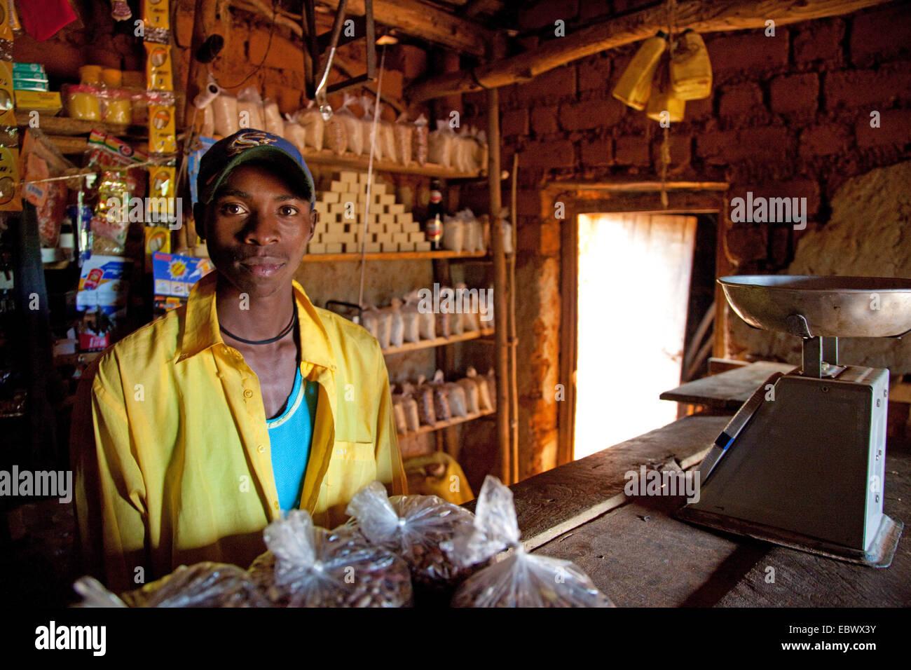 young salesman in a general store, Burundi, Cankuzo, near National Parc de la Ruvubu, Cankuzo - Stock Image